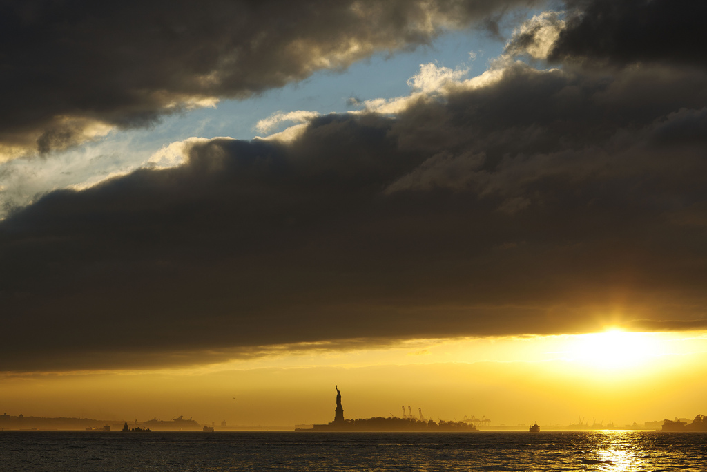 Sunset over Battery Park and Statue of Liberty
