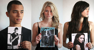 Models holding up their comp cards